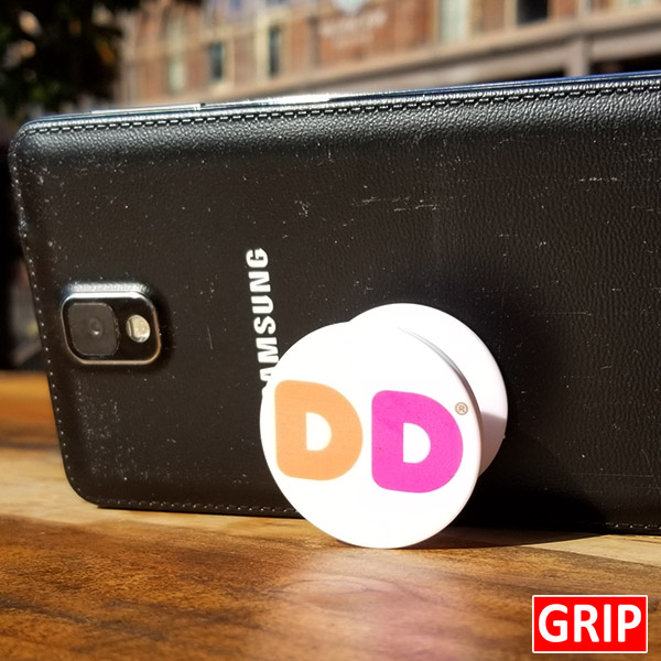 Dunkin Donuts. Round phone socket grip. Perfect for trade shows and b2b marketing. Free shipping, imprinted with your business logo. Event logo available. Let your logo pop.
